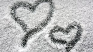two hearts on snowy window